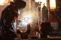 32107544-industrial-worker-at-the-factory-welding-closeup
